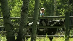 Young girl riding at boundary ranch kanaskis country alberta canada Stock Footage