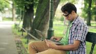 Stock Video Footage of Young happy man with laptop in the park, steadicam shot HD