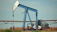 Alberta canada - august 20, 2012 nodding donkey oil well pump Stock Footage