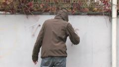 Stock Video Footage of vandalism graffiti writing on a white wall