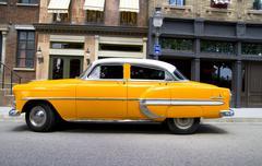 yellow 50's style vintage car - stock photo