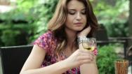 Sad, lonely beautiful woman drinking wine, steadicam shot HD Stock Footage