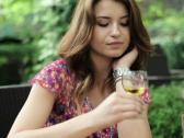 Sad, lonely beautiful woman drinking wine, steadicam shot NTSC Stock Footage