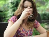 Young happy woman drinking wine, steadicam shot NTSC Stock Footage