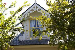beautiful country house attic window - stock photo