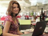 Stock Video Footage of Young happy woman with laptop in the cafe, steadicam shot NTSC