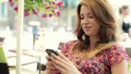 Happy young woman using smartphone in the city, steadicam shot HD Stock Footage