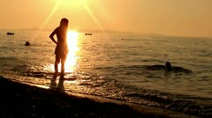 Man to the sea at sunset - stock footage