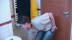 Woman using air freshener  in toilet Stock Footage