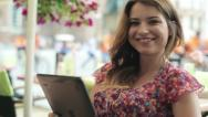 Stock Video Footage of Happy young woman with tablet computer in the city, steadicam shot HD