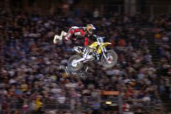 motocross extreme sport stunt rider on a dirt bike motorcross - stock photo