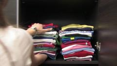 Clothes neatly arranged on a shelf Stock Footage