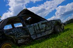 Stock Photo of Wrecked Car On A Farm