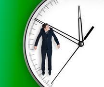 businessman hangs on an arrow of clock - stock photo