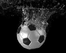 Soccer ball falling into water Stock Illustration
