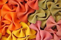 Colored farfalle pasta background Stock Photos