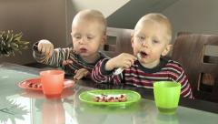 Twin boys eating breakfast Stock Footage