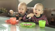Stock Video Footage of twin boys eating breakfast