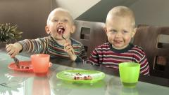 twin boys with dirty faces posing for picture - stock footage