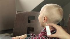 Sick child refusing nasal medicine Stock Footage