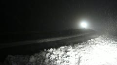 A snow plow tractor comes along in the night. Stock Footage