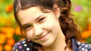 Stock Video Footage of Portrait of young girl smiling in the garden