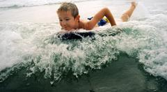 surfing boy - stock photo