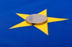 euro coin on eu flag - stock photo