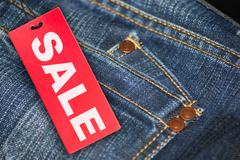 Jeans with sale tag Stock Photos