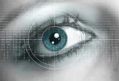 Eye close-up with technology background Stock Photos