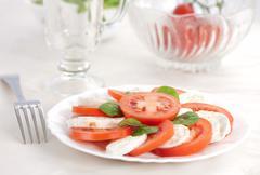 Italian salad with tomatos and mozarella cheese Stock Photos