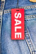 Stock Photo of jeans with sale tag