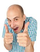 crazy man showing his thumb up - stock photo