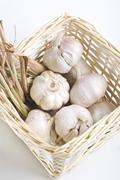 garlic and dried lemon grass inside a basket - stock photo