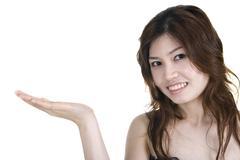 Asian girl with hand facing up Stock Photos
