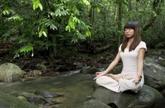 asian girl performing yoga - stock photo
