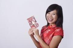 Stock Photo of chinese new year girl holding a red packet