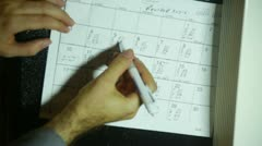 Scheduling schedule write writing calendar calander calender Stock Footage
