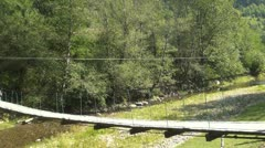 Mother, Child and their Dog Walking on a Suspended Bridge Stock Footage