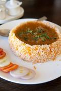 Tasty indian cuisine biryani chicken rice Stock Photos