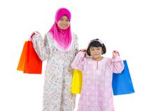 Muslim women with shopping bags Stock Photos