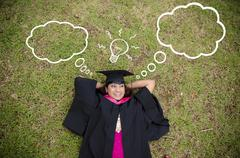 indian female graduate with laying and thinking about future prospects - stock photo