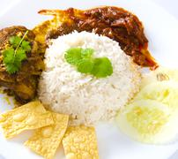 nasi lemak traditional malaysian spicy rice dish - stock photo