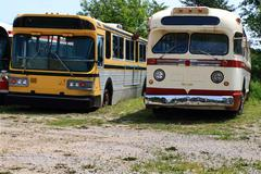 vintage public transportation vehicles - buses. - stock photo