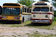 Vintage public transportation vehicles - buses. Stock Photos