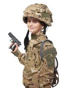 Young soldier with gun Stock Photos