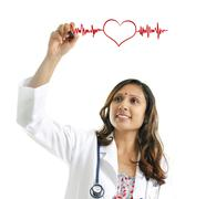 Doctor drawing a heartbeat Stock Photos
