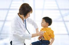 Children's doctor Stock Photos