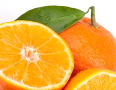 Tangerines with green leaves Stock Photos