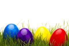 four easter eggs in grass - stock photo